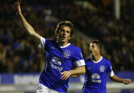 Everton's Baines celebrates his goal against Newcastle United during their English Premier League soccer match in Liverpool