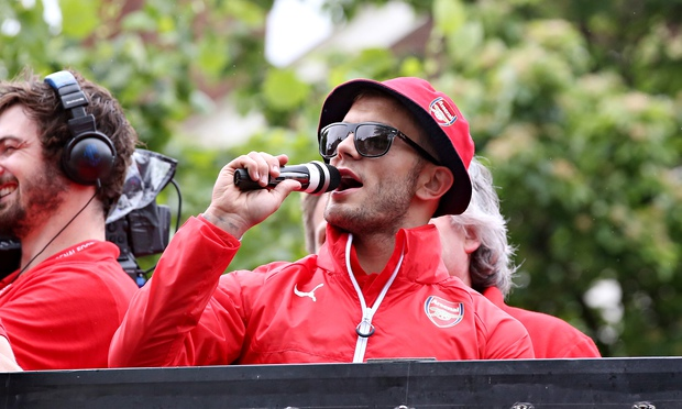 Jack Wilshere addresses Arsenal supporters during the club's FA Cup victory parade on Sunday