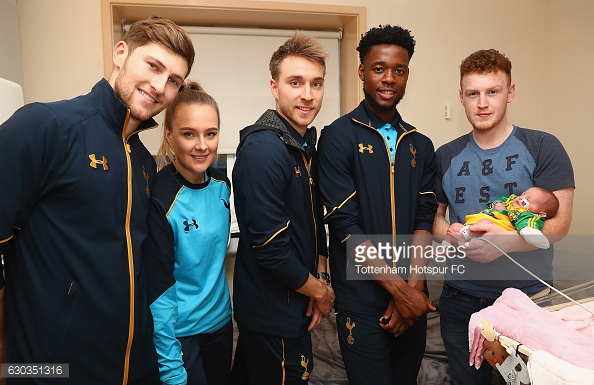of Tottenham Hotspur deliver Christmas presents to Children at Barnet Hospital on December 21, 2016 in London, England.